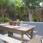 Outdoor-dining-area-with-tropical-plants