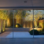 Bamboo-white-flowers-and-a-water-feature-turn-this-small-garden-into-a-showstopper