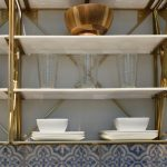 dacor-kitchen-gold-shelving-810x766