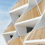 white-building-with-sculptural-facade-683x1024