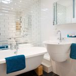 Small-bathroom-with-mirrored-tiles-Richard-Gadsby-920x920